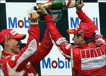 Michael Schumacher (left) and Felipe Massa celebrate their one-two finish