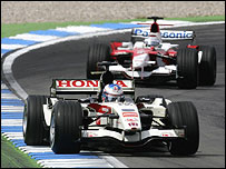Jenson Button leads Jarno Trulli during the German Grand Prix