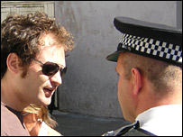 A police officer and Dan Simon
