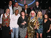 (Back Row) Mike Read, Tony Blackburn, Pat Sharp, Rufus Hound (Front Row) Dave Lee Travis, Reggie Yates, Janice Long, Sir Jimmy Saville, Edith Bowman, Sarah Cawood 