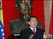 Venezuelean President Hugo Chavez stands speaking in front a a bust of late president Ho Chi Minh - 31/7/06
