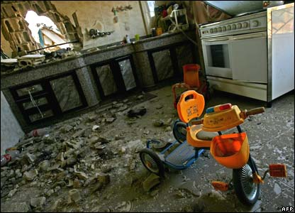 A tricycle lies in a bomb-damaged kitchen in Qana, Lebanon, after a deadly Israeli strike on the town