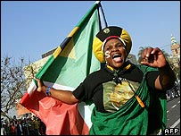 A supporter of South African ex-Deputy President Jacob Zuma outside the court in Pietermaritzburg, South Africa