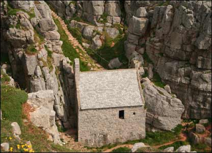 St Govan's Chapel nestled into the cliff face near the Castlemartin tank range (Mark Williams)