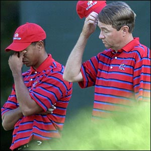 Tiger Woods (left) and Davis Love