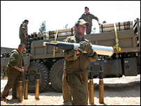 Israeli soldiers unload tank shells near Israel's border with Lebanon
