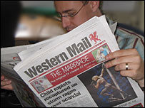 Man reading the Western Mail