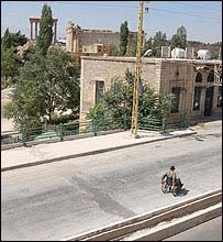 A lone man in a wheelchair on a Baalbek street