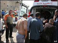 Wounded being loaded into an ambulance at the scene of the Karrada bomb blast