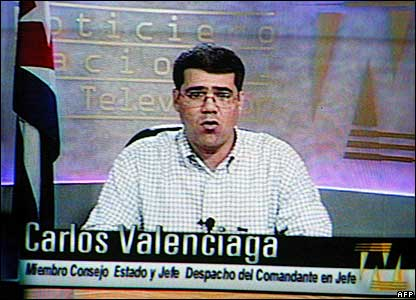 Spokesman Carlos Valenciaga reads Castro's statement on TV on Monday