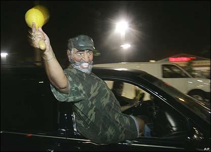 A reveller in a Castro mask, Hialeah, Florida
