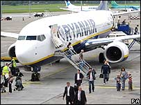 Passengers disembarking from a Ryanair flight