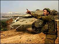 Israeli soldier directing a tank in Lebanon