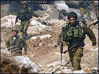 Israeli soldiers on the Lebanese side of the border with northern Israel