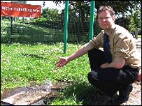 Head teacher Julian Thomas with the leak at his school