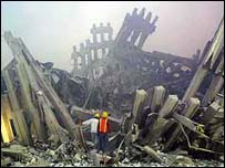 Firefighters climb through the rubble of the World Trade Center