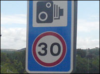 One of the 30mph signs through Llanfarian