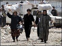 Lebanese villagers flee from the southern village of Aitaroun
