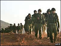 Israeli troops walking into Lebanon