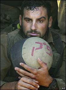Israeli soldier rests after coming back from Lebanon