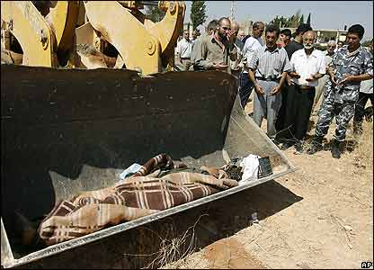 People mourn Awad Jamaleddin, 58, as he is carried away by bulldozer