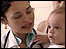 Baby with doctor in Cuba