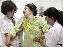 woman in shock is helped by medics in the hospital in the Israeli town of Nahariya after her village was hit by rockets