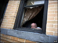 Queens resident Edward Butcher, 64, tries to keep cool beside his window