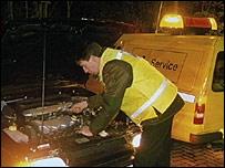 AA man repairing a car