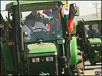 President Morales drives a tractor to a land reform ceremony in Urucena, Bolivia