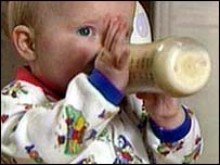 Image of a baby feeding from a bottle