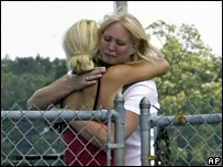 Friends of victims embrace