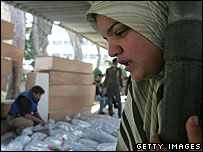 A woman views the bodies of Qana victims at a mortuary in Tyre, southern Lebanon, on 30 July 2006