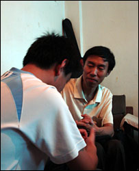 Le-le (back to the camera) with counsellor Mr Yang