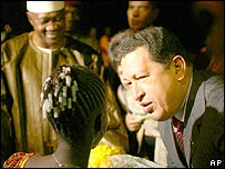 Venezuela's President Hugo Chavez thanks a girl in Mali for a gift given as a sign of respect