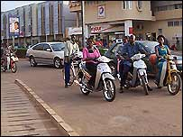 Bike riders in Ouagadougou, Burkina Faso