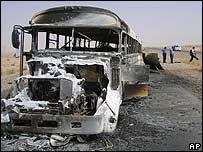 Bus burned out by a roadside bomb in Beiji
