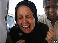 An Iraqi mother grieves after the violent death of her child