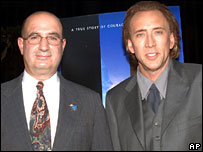 Police officer John McLoughlin and Nicolas Cage
