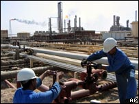 Workers at an oil refinery near Basra