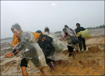 Residents leaving their homes in Zhongshan, Guangdong province, ahead of the typhoon