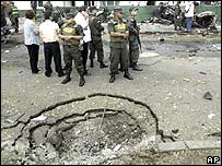 Crater left by a car bomb in Cali, Colombia, Friday 4 August 2006