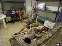 An Israeli family inside a bomb shelter in Kiryat Shmona on 4 August