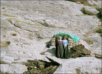 Women pause from work at the caves above Suceken village (copyright Maggie Ronayne)
