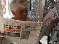 A Cuban woman reads the official Granma newspaper