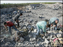 Men search the rubble following an Israeli air strike on the village of Qaa, near the Lebanon-Syria border, 4 August