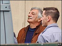 Julio Simon (L) leaves court in June