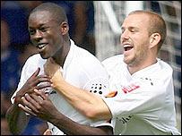 Leon Barnett (left) is congratulated by Rowan Vine after his goal for Luton