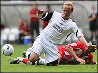 Thomas Butler in action for Swansea against Cheltenham