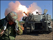 An Israeli artillery team fires shells into southern Lebanon from the Israel-Lebanon border